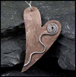 Copper and silver heart shaped pendant