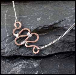 Copper and silver wire wrapped pendant