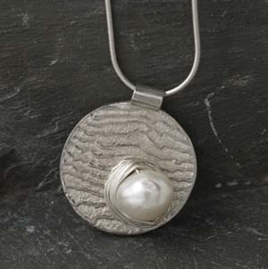 Silver cuttlefish cast round pendant with pearl