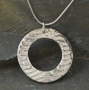 Silver cuttlefish cast round washer type pendant