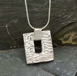 Silver cuttlefish cast oblong pendant with oblong hole in centre